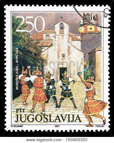 YUGOSLAVIA - CIRCA 1987 : Cancelled postage stamp printed by Yugoslavia, that shows Traditional dance in Korcula.