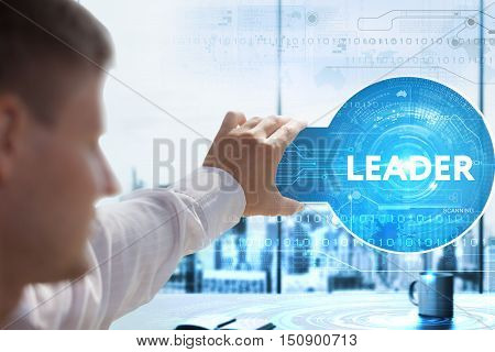 Business, Technology, Internet And Network Concept. Young Businessman Looks On A Tablet, Smart Phone
