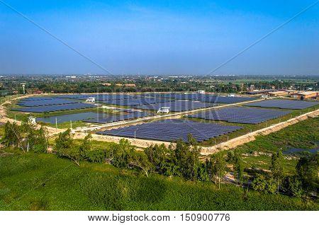 Solar farm solar panels aerial photo from the air