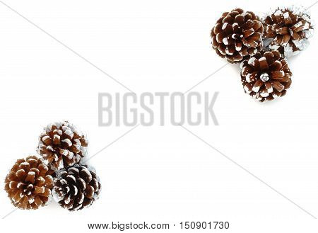 White Background with six hand painted snowy white pine cones isolated on white background. Three pine cones each in right top corner and left bottom corner.