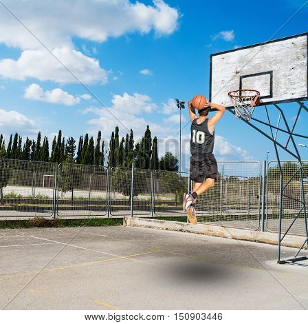 two handed jam in a basketball playground