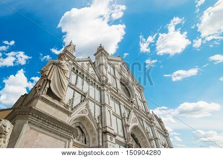 XIX century Dante Alighieri statue and Santa Croce cathedral in Florence Italy