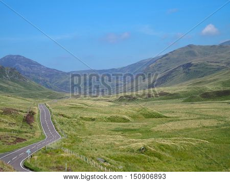 A road in beauty glen of Scottish Highlands