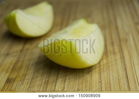 Half delicious apple on a wooden table