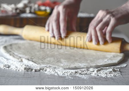 Rolling dough for calzone horizontal kitchen, blur, blurred