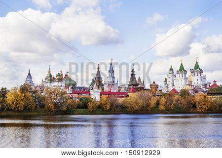 Fairytale russian castle near a lake in autumn.