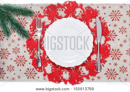 Vintage Christmas plate on holiday background with xmas tree. Canvas background with red glitter snowflakes. Xmas card. Happy New Year. Space for text