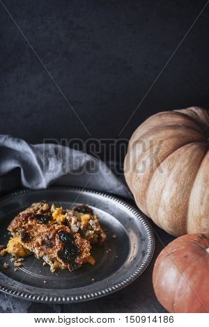 Pumpkin dump cake on the metal plate vertical