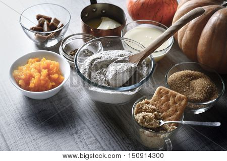 Ingredients for pumpkin dump cake on the white table horizontal