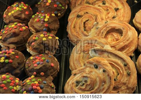Fresh confectionery puff pastry and chocolate with sprinkles
