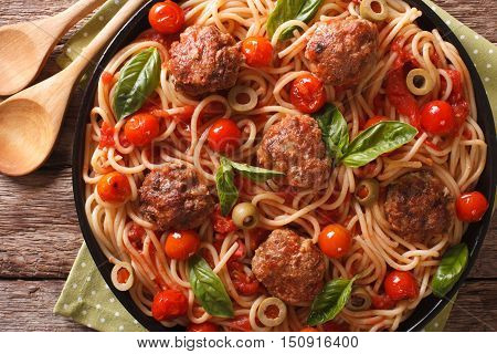 Italian Food: Spaghetti With Meatballs And Tomato Sauce Closeup On A Plate. Horizontal Top View