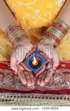 Handmade Diwali Diya Lamp in Female Hand