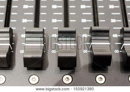 Regulators mixer close-up. Shallow depth of field. Mixing console. Sound mixer. Live and studio equipment