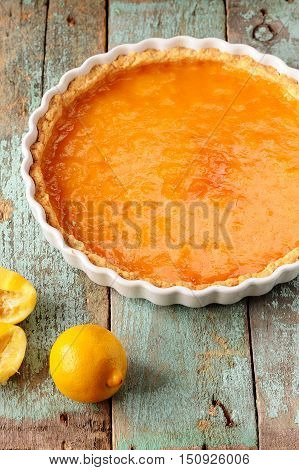 Lemon pie with fresh and squeezed lemon vertical