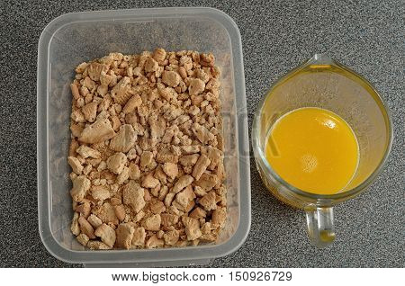 Crushed biscuits and melted butter to prepare a crust