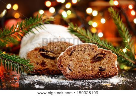 Stollen christmas cake slice closeup with ligths