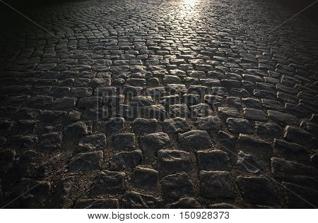 the Granite cobblestones of block pavement background