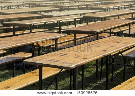 Empty wooden tablse for product placement on the morning sun
