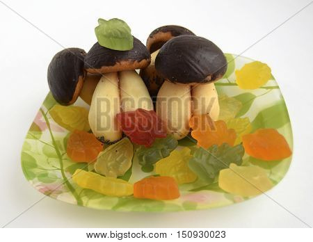 Cookies in the form of mushrooms and autumn leaves from candies. Original food for good mood and appetite