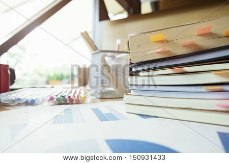 Books With Post-it Bookmarks On Working Table.