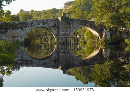 landscape roman bridge reflection in calm waters