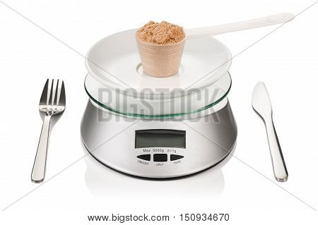 Product photograph of scoop of whey protein on a kitchen weight. Concept photograph illustrating strict diet and weighting of meals.
