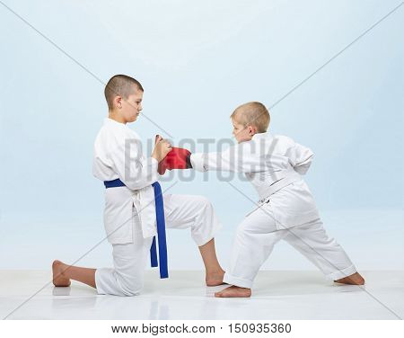 With overlays on hands karateka in karate gi beats punch on simulators