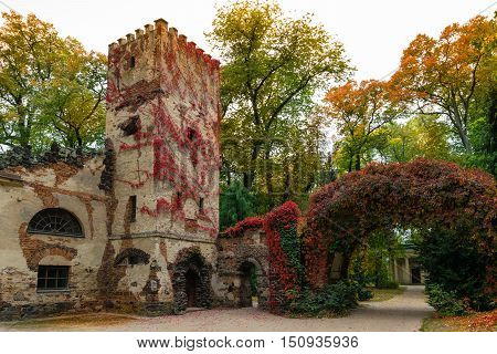 Arkadia Poland - September 30 2016: Burgrave's house and stone arch in the sentimental and romantic Arkadia park near Nieborow Central Poland Mazovia. Garden in the English style