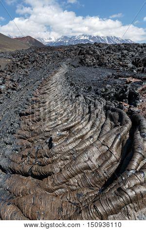 Volcanic landscape of Kamchatka: view of lava field volcanic eruption active Plosky Tolbachik Volcano on a clear sunny weather. Eurasia Russian Far East Kamchatka Peninsula Klyuchevskaya Group of Volcanoes.