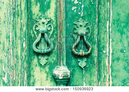 Colorful door with door knockers in a typical Portugese house