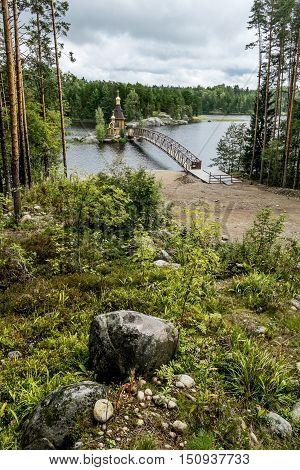 Vasiliyevo.Russia.15 Aug 2016 .View of the Church of St. Andrew on the island on the lake Vuoksa in Karelia.