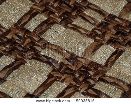 Decorative multicolored interweaving of materials and fibers creates a geometric pattern