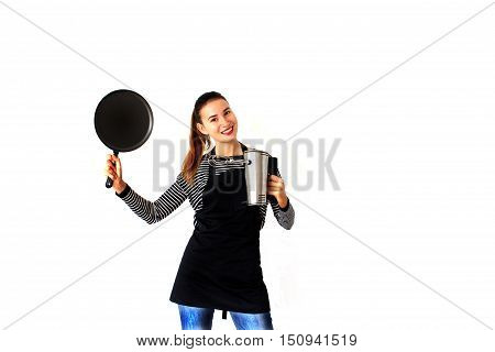 Girl working in the kitchen with dishes