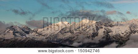 First beams of a rising sun it is high in mountains. Greater Caucasus Mountain Range. Caucasus mountains. Karachay-Cherkessia. Russia.