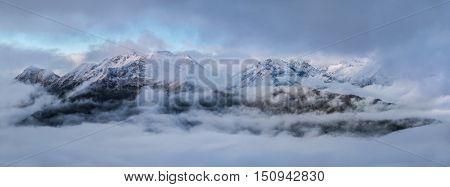 Dawn high in mountains on a foggy morning. Greater Caucasus Mountain Range. Caucasus mountains. Karachay-Cherkessia. Russia.