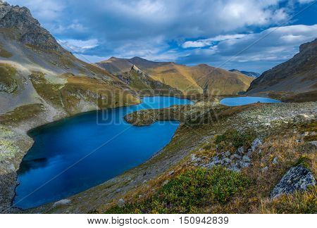 Blue lakes in the mountain valley. Urup lakes from which the river originates Left Urup. Caucasus mountains. Karachay-Cherkessia. Russia.