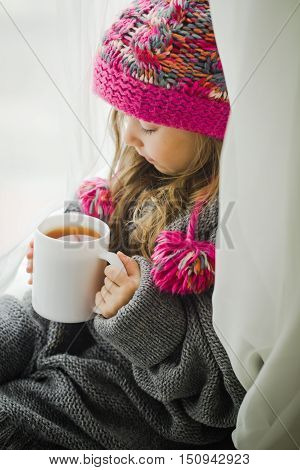 Cute Little Girl In Fashionable Winter Clothes