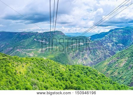 The cables of Wings of Tatev cableway stretch across the Vorotan river canyon from Tatev Monastery to Halidzor village Syunik Province Armenia.