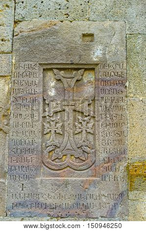 The Khachkar with three crosses is built in wall of St Peter and Paul Basilica and contains medieval armenian inscriptions Tatev Monastery Syunik Province Armenia.
