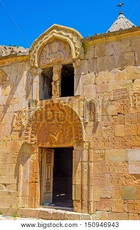 The sculptures on the facade of Surb Karapet (St John the Baptist) Church of Noravank Monastery depict the Virgin Mary with Baby Jesus and God the Father on the upper relief Vayots Dzor Armenia.
