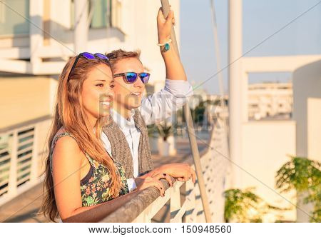 Hipster couple taking selfie during tour trip in european capital. Fashion traveler best friends having emotional fun together and posing. Love concept with girlfriend at first dating.