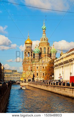 ST PETERSBURG RUSSIA -OCTOBER 3 2016. Cathedral of Our Saviour on Spilled Blood and Griboedov channel in St PetersburgRussia in sunny autumn day. Architecture autumn view of St Petersburg landmark
