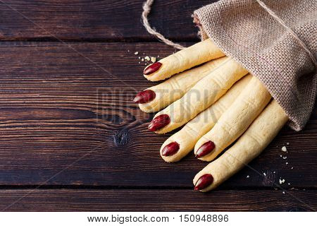 Cookies Witch's fingers for Halloween party celebration. Wooden background Copy space Top view.