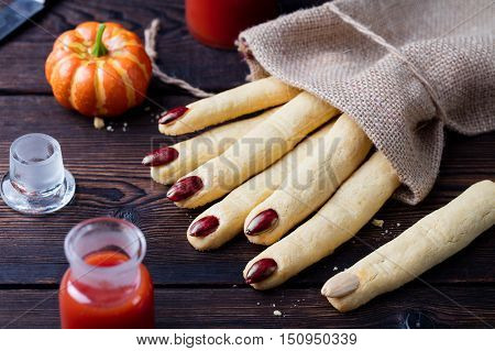 Cookies Witch's fingers for Halloween party celebration. Wooden background Top view.