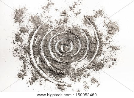 Spiral drawing in scattered grey ash as wormhole order in chaos