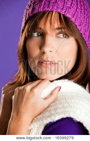Portrait of a beautiful woman with a lovely espression, over a violet background