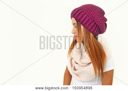greek model advertises crochet scarf and beanie