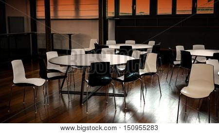 Modern cafeteria with wooden floor and decorative tables