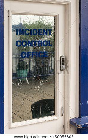 Funny Sign On Broken Glass Door