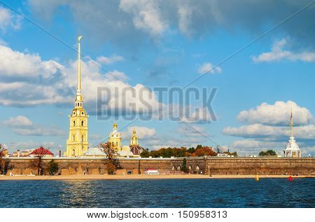 Architecture panorama of St Petersburg Russia- architecture ensemble of Peter and Paul fortress and Neva river in sunny autumn day. Autumn architecture view of St Petersburg landmark in sunny weather